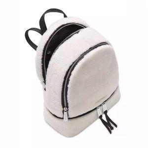 Michael Kors Bags - Michael Kors Rhea Med Leather Fur Black & White